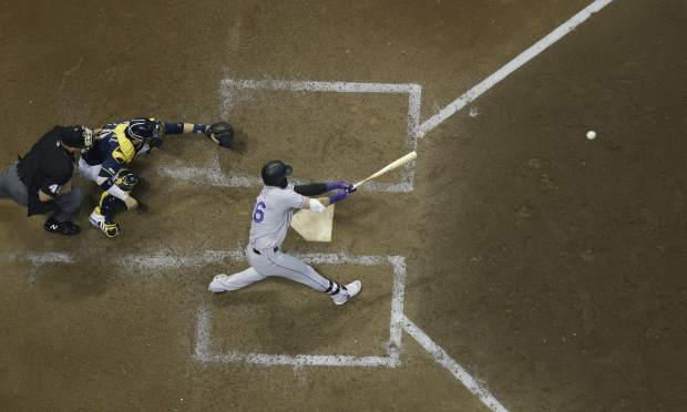 Colorado Rockies' David Dahl hits an RBI single during the sixth inning of a baseball game against the Milwaukee Brewers Monday, April 29, 2019, in Milwaukee. (AP Photo/Morry Gash)
