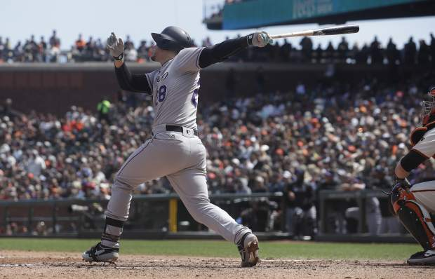 Colorado Rockies' Nolan Arenado hits a three-run home run against the San Francisco Giants during the fifth inning of a baseball game in San Francisco, Sunday, April 14, 2019. (AP Photo/Jeff Chiu)