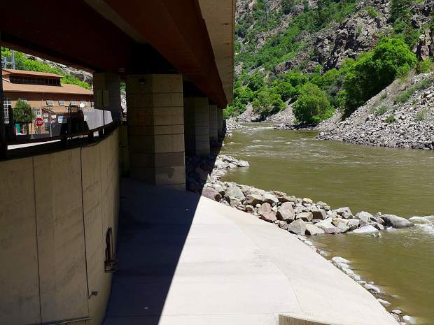 The Colorado River, pictured under Interstate 70, heads toward the Shoshone Generating Plant, which returns water from its turbines to the river just above the boat ramp. The ramp is often filled with boaters putting in for the Shoshone run, an expert stretch above the mellower run from Grizzly Creek to Two Rivers Park.
