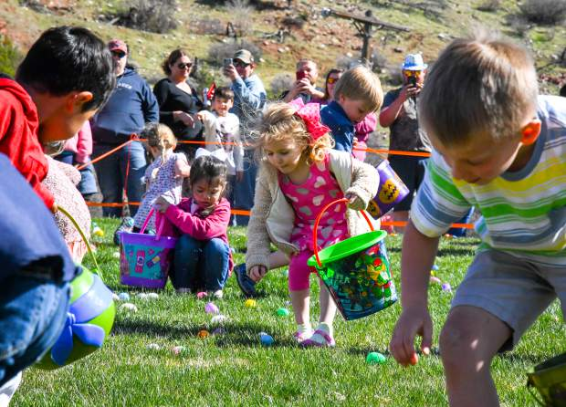 Hundreds of kids race to grab as many eggs as possible at the Easter egg hunt at the New Creation Church in New Castle on Saturday morning.
