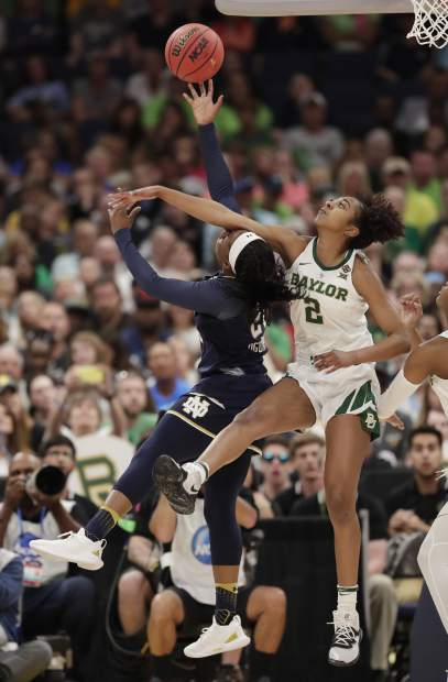 Baylor guard DiDi Richards (2) attempts to block a shot by Notre Dame guard Arike Ogunbowale (24) during the first half of the Final Four championship game of the NCAA women's college basketball tournament Sunday, April 7, 2019, in Tampa, Fla. (AP Photo/John Raoux)
