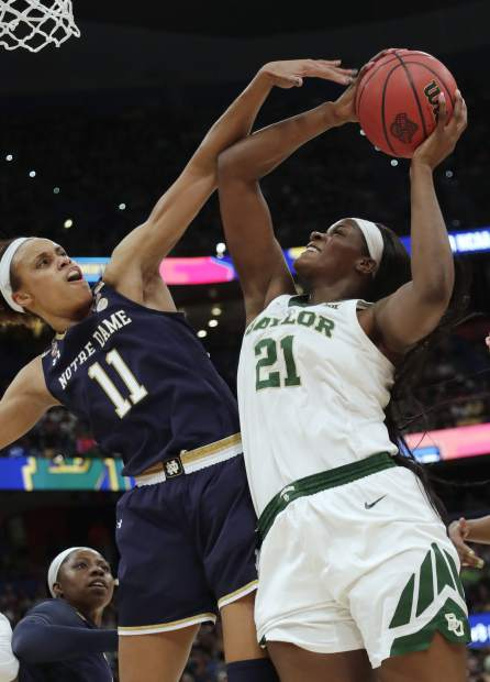 Notre Dame forward Brianna Turner (11) attempts to block a shot by Baylor center Kalani Brown (21) during the first half of the Final Four championship game of the NCAA women's college basketball tournament Sunday, April 7, 2019, in Tampa, Fla. (AP Photo/John Raoux)