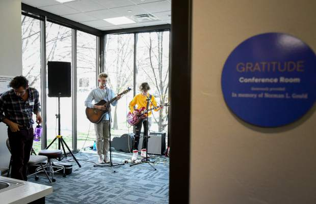 A young band plays at the YouthZone grand opening celebration at the new location inside the old Glenwood Springs Library on Thursday evening.