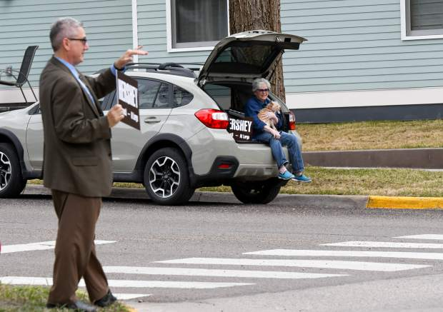 Tony Hershey does one last extra push of campaigning at the corner of 11th and Pitkin Tuesday afternoon, as his mother, Carole Hershey, looks on from the back of the car. Hershey won the three-way race for the at-large Glenwood Springs City Council seat over Jim Ingraham and Erika Gibson.