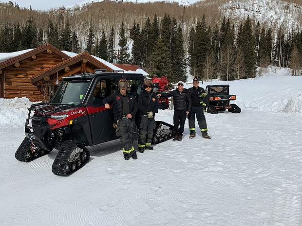 Aspen Fire Department Battalion Chief Ken Josselyn (left, Capt. Sandy Schiff, Johnny Wilcox of Pine Creek Cookhouse and Fire Chief Rick Balentine stand with the newoff-road, quick-response vehicle the fire department purchased this winter from donations.