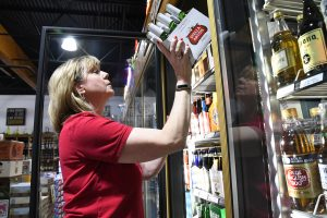 Area liquor stores remain in good spirits, despite grocery, convenience store full-strength beer sales