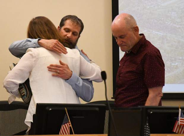 Councilman and newly selected Glenwood Springs Mayor Jonathon Godes is congratulated by Shelley Kaup and Rick Voorhees during Thursday night's council meeting.