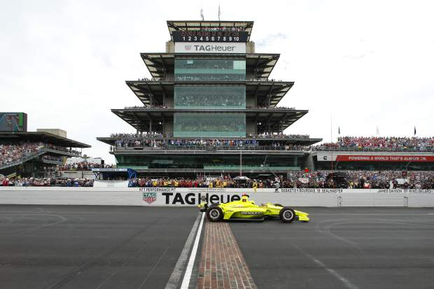 Simon Pagenaud, of France, crosses the start/finish line on the start of the Indianapolis 500 IndyCar auto race at Indianapolis Motor Speedway, Sunday, May 26, 2019, in Indianapolis. (AP Photo/Rob Baker)