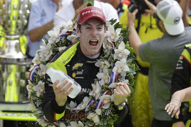 Simon Pagenaud, of France, celebrates after winning the Indianapolis 500 IndyCar auto race at Indianapolis Motor Speedway, Sunday, May 26, 2019, in Indianapolis. (AP Photo/Darron Cummings)