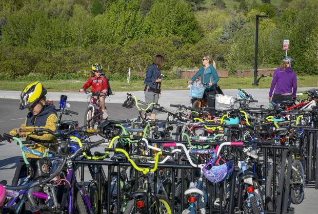 Glenwood Springs Elementary students look for a spot to store their bikes during Garfield County Schools Bike to School Day Tuesday in Glenwood. Schools from Glenwood, Carbondale, New Castle, Rifle, Silt and Parachute took paet in the event organized by Garfield Clean Energy, Garfield County Putdoors and the schools.