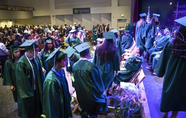 The class of 2019 from Bridge High School files in the The Orchard Friday evening in Carbondale for commencement. Twenty-nine students earned their diplomas during the event.