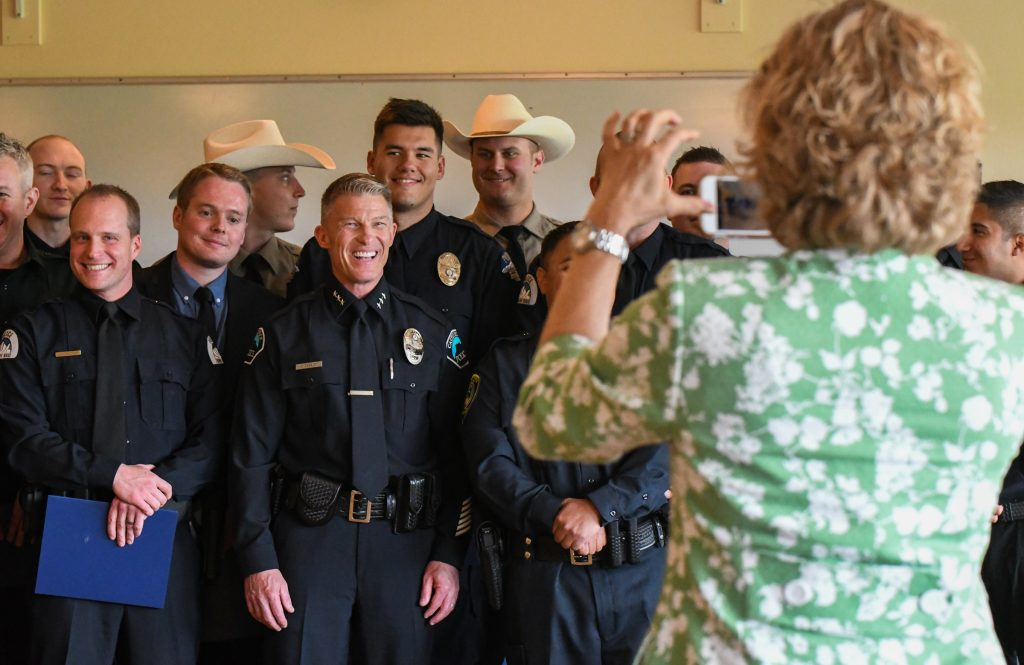 Colorado Mountain College President Carrie Besnette Hauser takes a group photo of the CLETA graduates along with Castle Rock Police Chief Jack Cauley (middle) after the graduation ceremony at the Spring Valley Campus on Thursday afternoon.