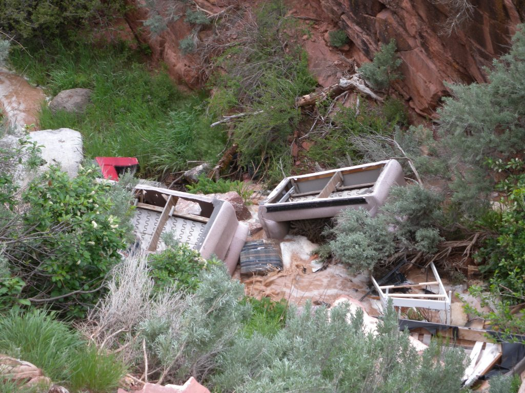 Trash piles up in Red Canyon Creek as a result of illegal dumping over the years.