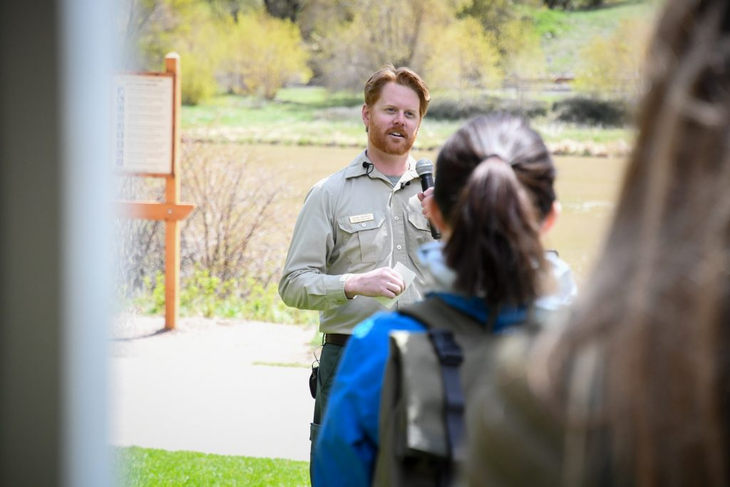 Aaron Mayville with the White River National Forest Service speaks about the importance of the new reservation system will be in preserving Hanging Lake during the ceremony at the trailhead on Wednesday morning.