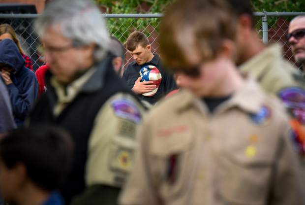 A member of the audience lowers his head during the Benediction near the closing of the 2019 Memorial Day ceremony held at Rosebud Cemetery in Glenwood Springs on Monday.