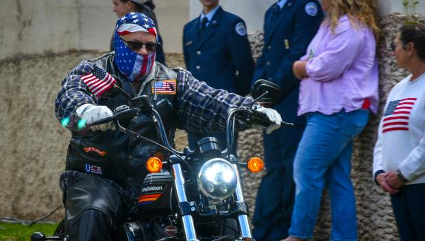 A member of the Western Slope Memorial Riders leaves with the rest of the