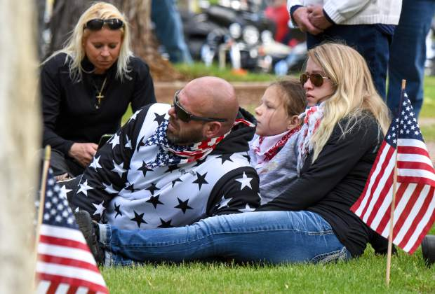 Members of the audience sit together during the opening of the 2019 Memorial Day ceremony held at Rosebud Cemetery in Glenwood Springs on Monday.