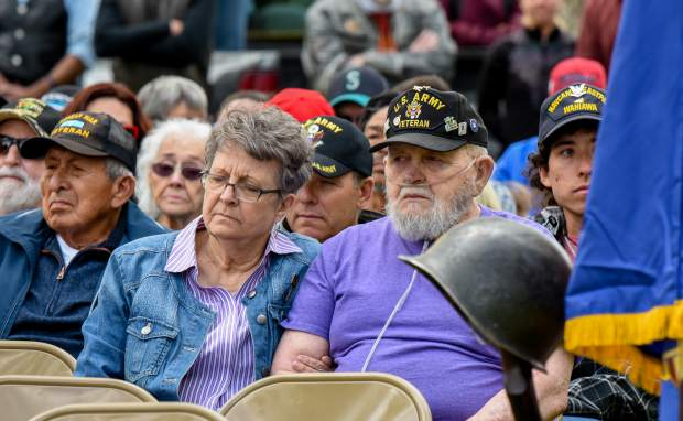 Members of the audience sit together and listen to the rendition of Amazing Grace by Catherine Zimney during the 2019 Memorial Day ceremony held at Rosebud Cemetery in Glenwood Springs on Monday.