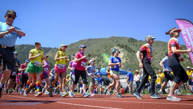 Runners start heat 2 of the Mother's Day Mile Sunday morning at Glenwood Springs High School. More than 400 people turned out to honor Nancy Reinisch with one last Mother's Day Mile, an event that she helped create.