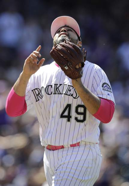 Colorado Rockies starting pitcher Antonio Senzatela points skyward as he leaves a baseball game in the seventh inning against the San Diego Padres in Denver, Sunday, May 12, 2019. (AP Photo/Joe Mahoney)