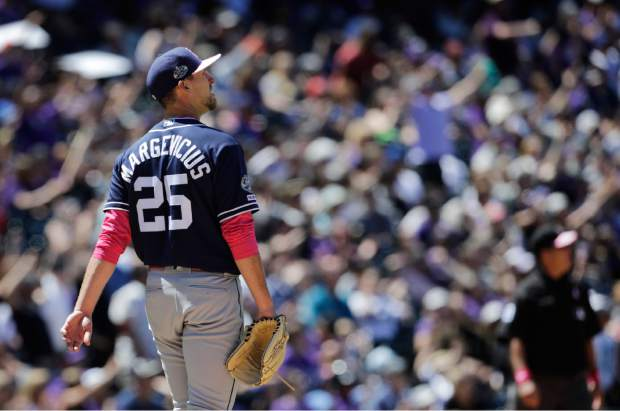 San Diego Padres starting pitcher Nick Margevicius (25) watches a home run by Colorado Rockies' Charlie Blackmon in the fourth inning of a baseball game in Denver, Sunday, May 12, 2019. (AP Photo/Joe Mahoney)