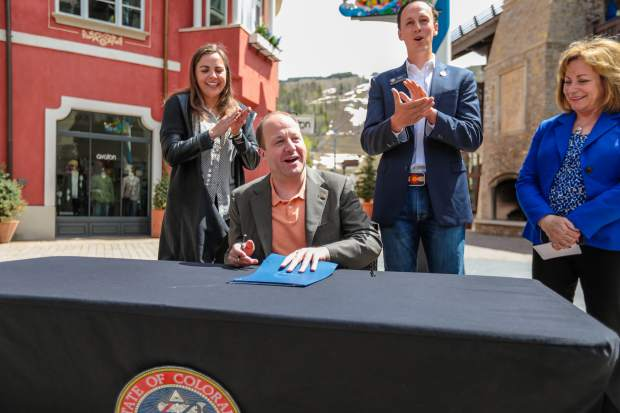 Colorado Gov. Polis signs landmark health care legislation in Vail