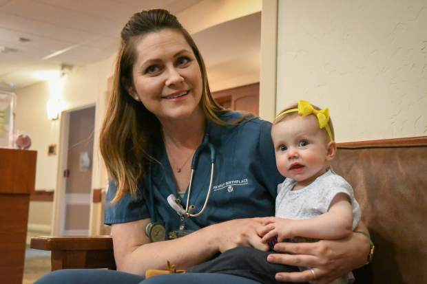 Valley View Hospital nurse Courtney Pollard and her daughter Landry spend time together near the nursery at the Family Birthplace on Thursday morning.