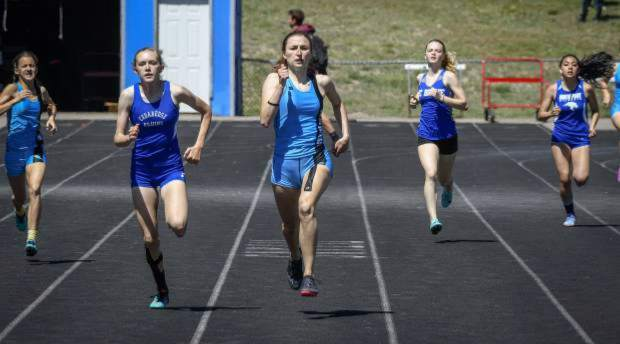 Coal Ridge senior Kara Morgan sprints to the finish line at the end of a 400m heat at the Titan Invitational in the middle of April.