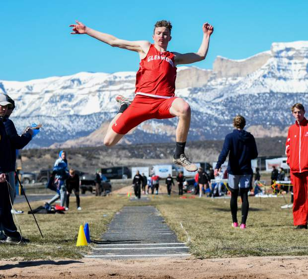 Glenwood Springs' AJ Adams flies through the air in the triple jump March 15 at Rifle High School.