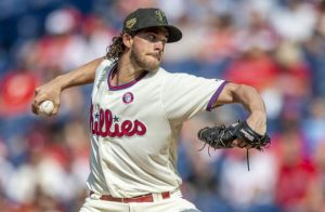 Harper's bat, Nola's arm lead Phillies past Rockies 2-1
