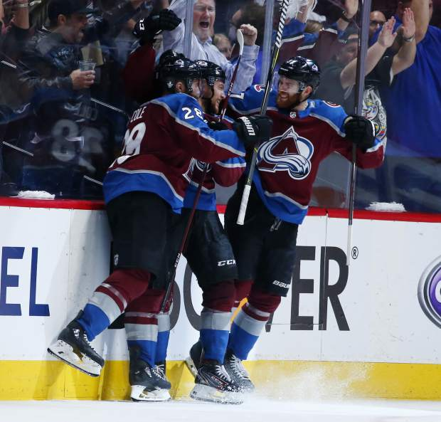 Colorado Avalanche center Tyson Jost, center, is congratulated after scoring a goal by defenseman Ian Cole, left, and left wing J.T. Compher in the second period of Game 6 of an NHL hockey second-round playoff series against the San Jose Sharks, Monday, May 6, 2019, in Denver. (AP Photo/Jack Dempsey)