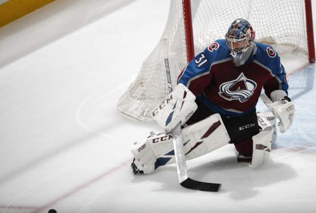 Colorado Avalanche goaltender Philipp Grubauer deflects the puck in the first period of Game 6 of an NHL hockey second-round playoff series against the San Jose Sharks, Monday, May 6, 2019, in Denver. (AP Photo/David Zalubowski)