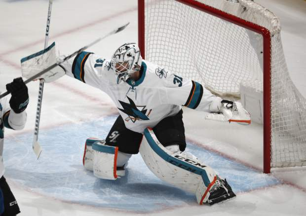 San Jose Sharks goaltender Martin Jones deflects a shot in the first period of Game 6 of an NHL hockey second-round playoff series against the Colorado Avalanche, Monday, May 6, 2019, in Denver. (AP Photo/David Zalubowski)