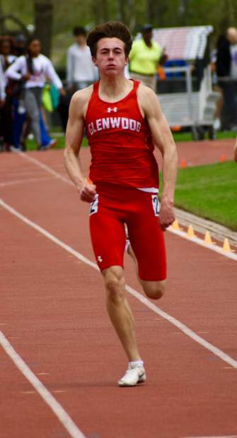 Senior Gavin Olson sprints to the finish line in the 200m dash Thursday afternoon in Lakewood.