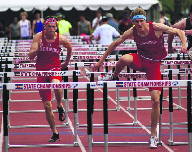 Seniors Bryce Risner (right) and Wyatt Ewer (left) leap over hurdles during the 110m hurdles race in Lakewood. Risner won the heat in 15.23 seconds, while Ewer placed third in 15.75 seconds. Both will race in the 110m hurdle finals.