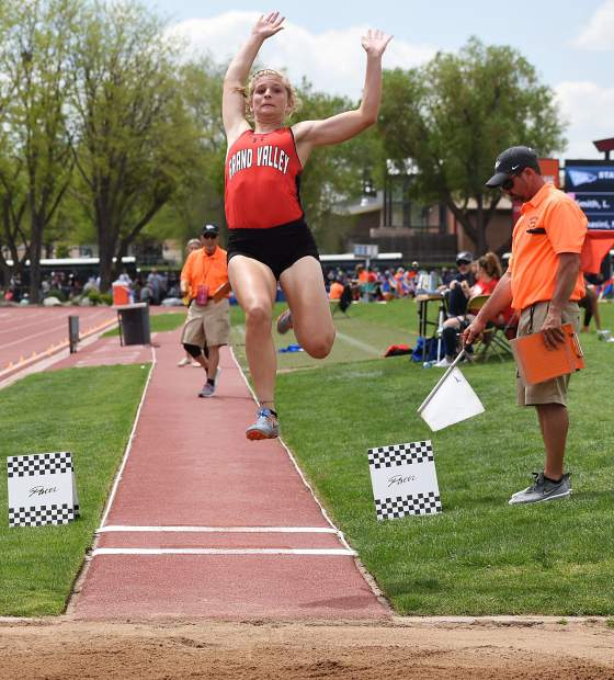 Grand Valley senior Shaya Chenoweth flies through the air toward the sand pit in the 3A long jump Friday in Lakewood.