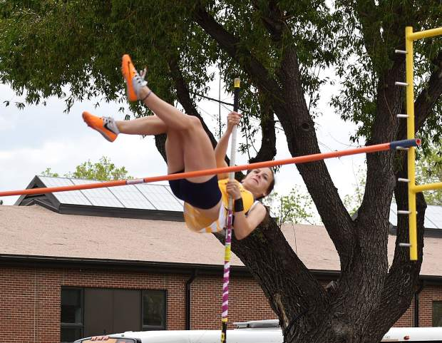 Rifle pole vaulter Ashley Manera clears the bar early in the competition Friday at JeffCo Stadium.