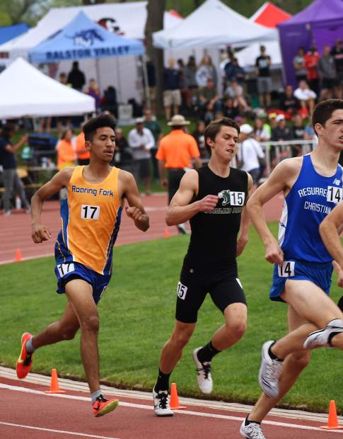 Roaring Fork's Ronald Clemente races into the second turn of the 800m run Friday at JeffCo Stadium.