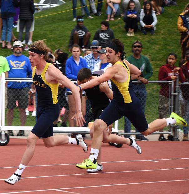 Rifle's Embrey Marantino hands the baton off to Bryce Schanche in the 4x200m relay. Rifle placed third.