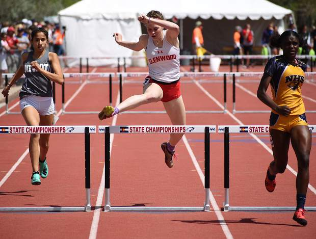 Glenwood Springs senior Sequoia Kellogg leaps over the hurdle near the finish line of the 100m hurdles Friday morning at JeffCo Stadium.