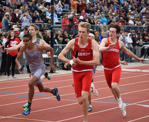 Glenwood's Gavin Olson hands the baton off to Bryce Risner to start the second lap of Saturday's 4x400m relay in Lakewood. Glenwood finished sixth.