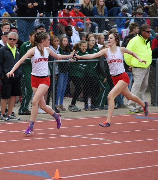Glenwood sophomore Sophia Vigil hands the baton off to senior Emily Worline in the 4x400m relay Saturday in Lakewood. Glenwood finished fifth.