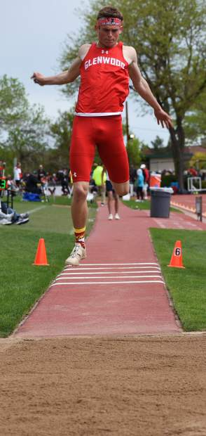 Glenwood Springs senior Wyatt Ewer flies through the air in the 4A triple jump Saturday in Lakewood.