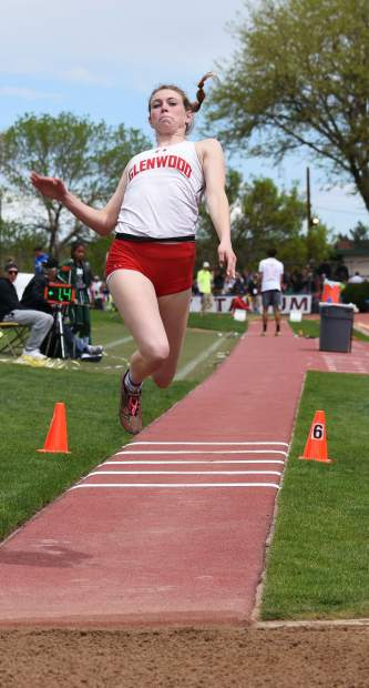 Glenwood's Sequoia Kellogg stretches in the air during the 4A triple jump at JeffCo Stadium.