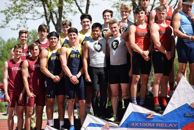 The Rifle Bears' boys 4x100m relay team of Tanner Vines (left, front), Dalton Pruett (right, front), Bryce Shanche (back, left) and Embrey Marantino (back, right) stands on the podium Saturday in Lakewood.