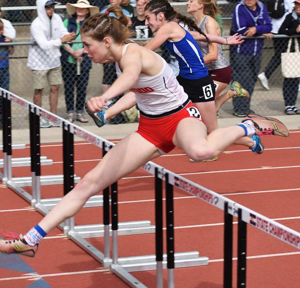 Glenwood senior Sequoia Kellogg leaps over a hurdle in the 100m hurdles Saturday morning in Lakewood.