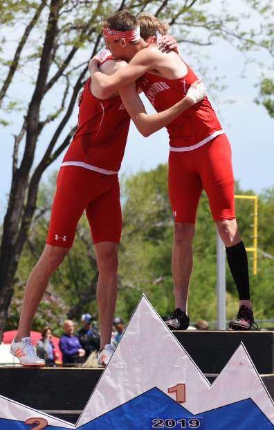 Glenwood Springs seniors Bryce Risner, left, and Wyatt Ewer hug on top of the championship podium after the 4A 300m hurdles Saturday in Lakewood. The senior duo finished 1-2.