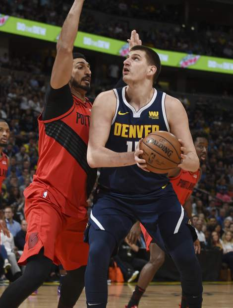 Denver Nuggets center Nikola Jokic, right, goes up for a basket Portland Trail Blazers center Enes Kanter, left, in the first half of Game 7 of an NBA basketball second-round playoff series Sunday, May 12, 2019, in Denver. (AP Photo/John Leyba)