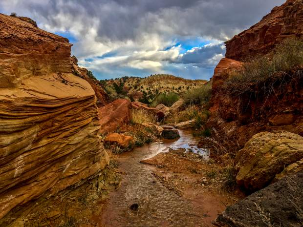A babbling brook flows through rocks and boulders near the Sunglow Campground near Bicknell, Utah. Sometimes the best hikes are found just on the other side of your campground.