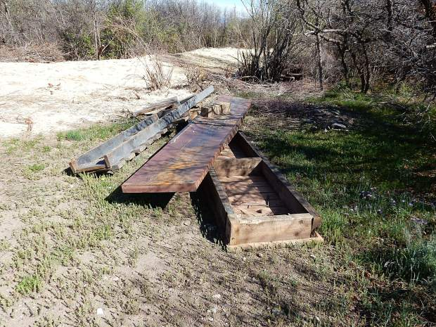 The bridges erected over the irrigation ditch were flung by an excavator into the woods, then later pulled out, according to one observer.